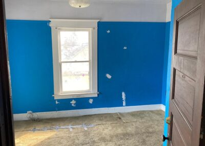 Bedroom blue Before JxB Properties sell your home as is