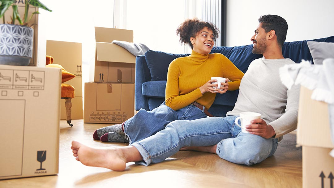 young couple discussing their motivation to move homes in 2021 housing market